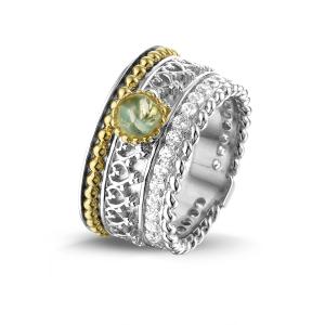 Zilver met 14 krt gouden ring en zirkonia's.