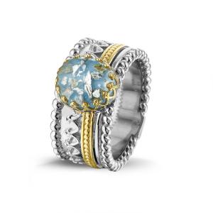 Zilver met 14 krt geel gouden ring.-