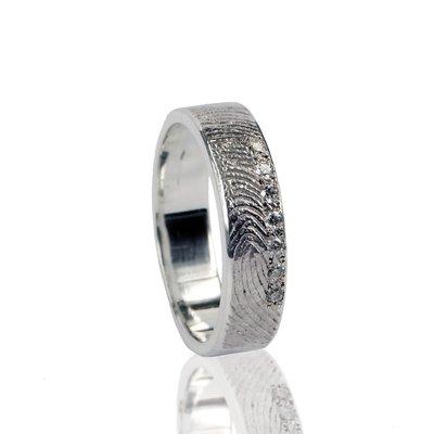 Zilveren ring met vingerafdruk en 7 stenen