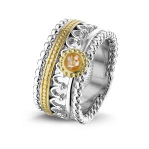 Zilver met 14 krt geel gouden ring.
